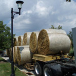 Truck overloaded with hay bales